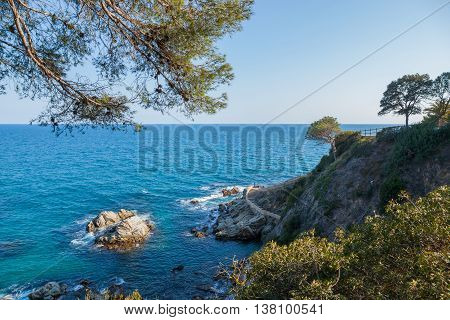 View over the cliffs and the coastal footpath at Lloret de Mar Costa Brava Catalonia Spain.