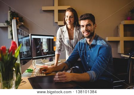 Portrait of graphic designers using a graphics tablet in office