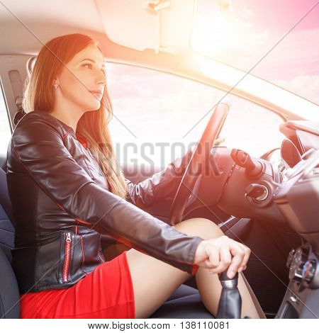 Young Happy Woman Driving A New Or Rented Car