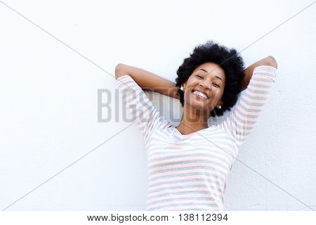 Carefree Woman Leaning Back With Hands Behind Head