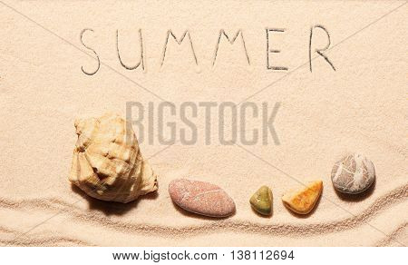 Seashell, Sea Stones And Summer Lettering Drawn On Sand