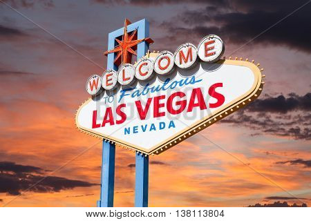 Las Vegas welcome sign with sunrise sky.