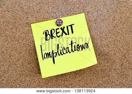 Yellow Paper Note Pinned With Great Britain Flag Thumbtack And Text Brexit Implications