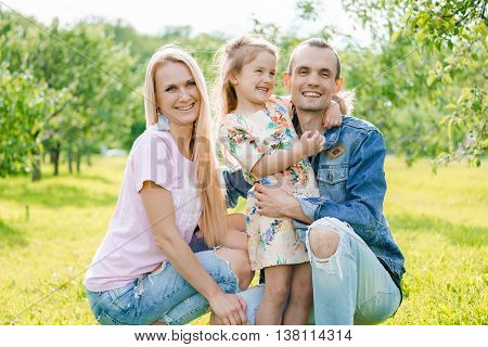 Portrait of young happy family at outdoos