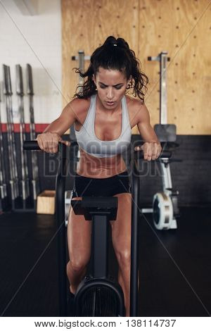 Fitness Woman On Bicycle Doing Cardio Workout At Gym