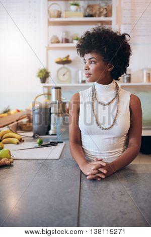Young African Woman At Juice Bar