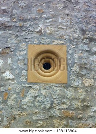 Small Round Window In A Fortress Wall