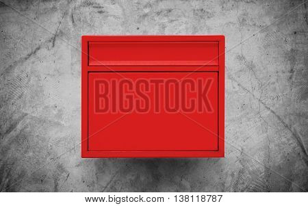 Red mailbox on concrete wall texture background