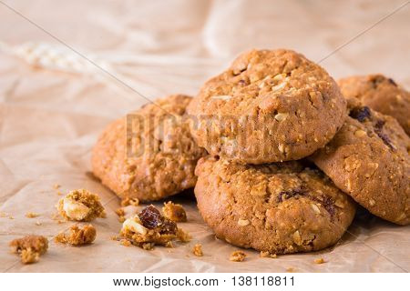 Chocolate Cookies Raisins placed on the brown paper.