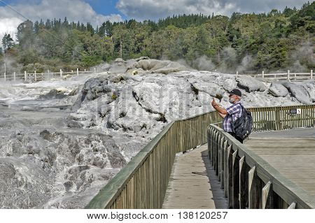 Whakarewarewa Geyser at Te Pui thermal park in geothermal valley of Rotorua New Zealand