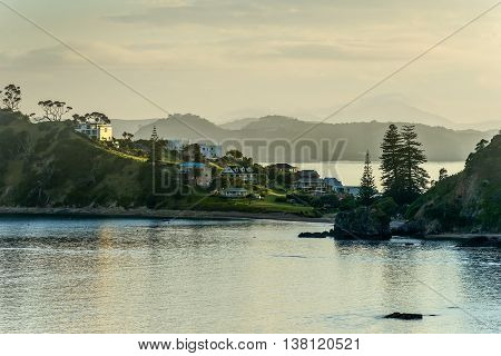 The sun rises on a beautifully calm morning in New Zealand's Bay of Islands