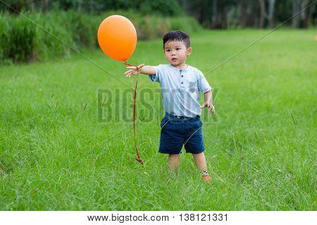 Little boy play balloon at outdoor