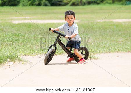 Little boy riding a bike at outdoor