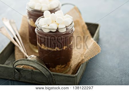 Smores chocolate pudding in a jar with crackers and marshmallows
