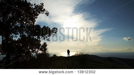 Men silhouette on the sea background in Crimean mountain