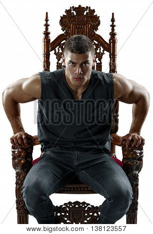 Terrible muscular man rises from his throne. Isolated.