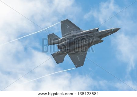 FARNBOROUGH, UK - JULY 5: Low level aerobatics by a Lockheed Martin F-35B Lightning II in the skies over Farnborough, Hampshire, UK on July 5, 2016