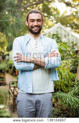 Portrait of confident young male owner at community garden
