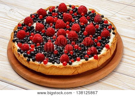 Tart  with creme, blueberries, raspberries and red currants.