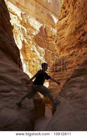 Girl climb on the canyon rock