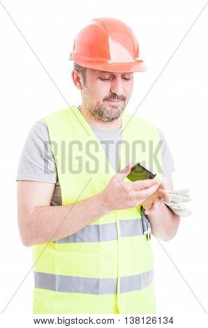 Portrait Of Young Constructor Working With Modern Telephone