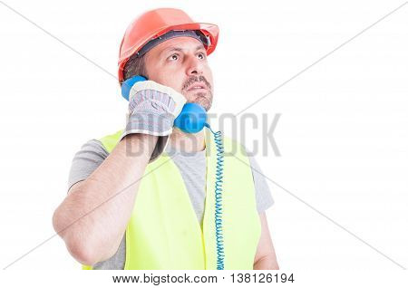 Serious Constructor Calling Someone To Solve Work Problem