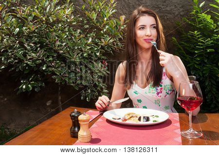 Lady Sitting On Terrace And Eating Lunch