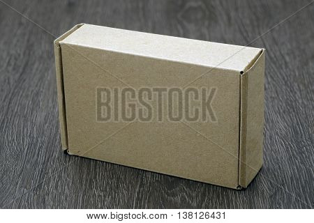 Blank Brown Box Mock Up On Wood Background