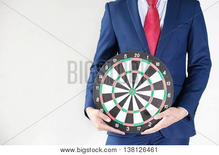 Businessman Holding Dartboard - Business Targeting Concept