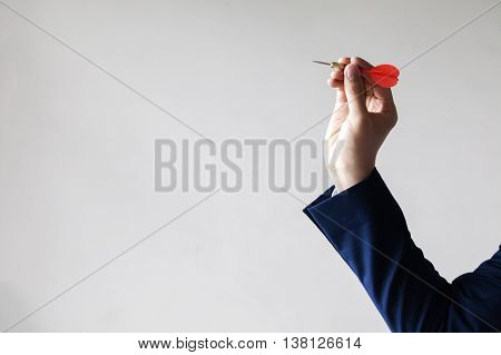 Businessman Holding A Dart Aiming At The Target - Business Targeting, Aiming, Focus Concept.