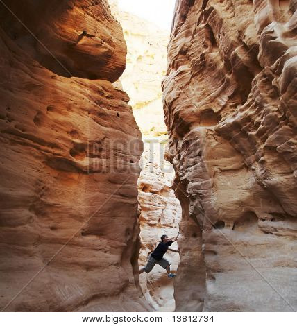 girl climbing in the canyon walls