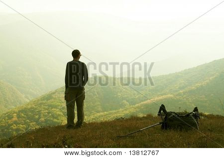 Alone man overview autumn landscape