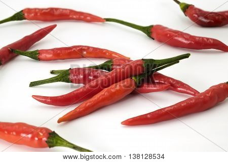 Handful of red hot Thai chili papers on white background