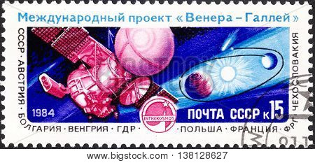 MOSCOW RUSSIA - DECEMBER 2015: a post stamp printed in the USSR shows space equipment and devoted to the International Venus-Halley's Comet Space Project circa 1984