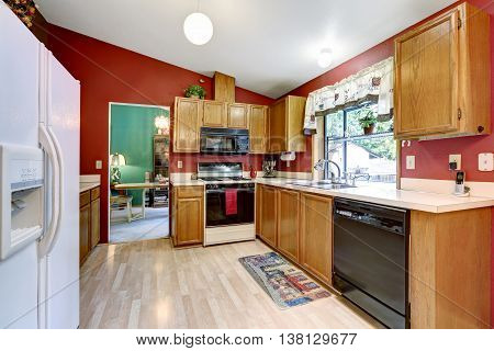 Kitchen Room With Red Wall, Vaulted Ceiling And Dining Table Set.
