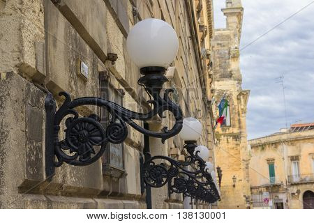 Lecce street lamps aligned on the wall