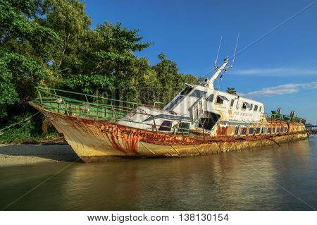 Labuan,Malaysia-July 12,2016: Abandoned broken ferry ship wreck known as Duta Muhibbah Dua beached on sea shore at Labuan island,Malaysia on 12th July 2016.