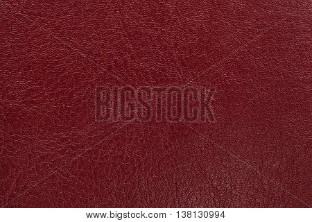 Dark red leather texture background. Closeup photo. Reptile skin. The skin of a crocodile or a snake