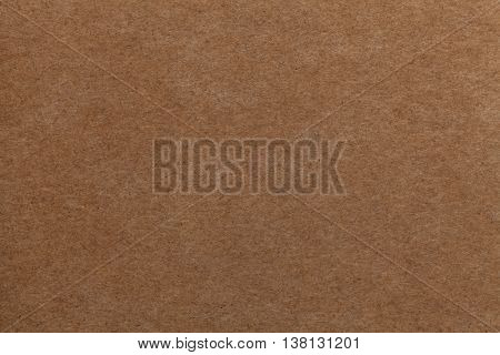 Brown old paper background. Thick cardboard. Paper texture