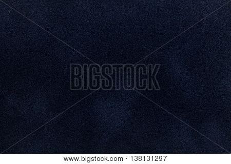 Dark blue suede fabric closeup. Velvet texture background
