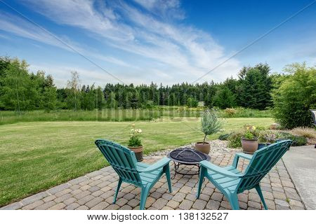 Beautiful House Backyard With Well Kept Lawn, Trees