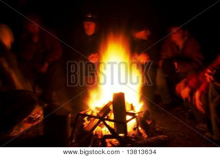 People around campfire