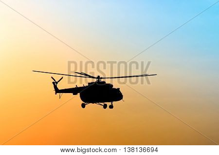 transport helicopter silhouette on blue yellow background