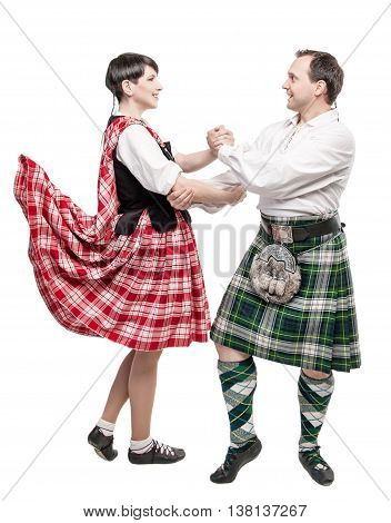 The pair woman and man dancing Scottish dance isolated