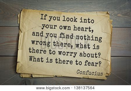 Ancient chinese philosopher Confucius quote on old paper background. If you look into your own heart, and you find nothing wrong there, what is there to worry about? What is there to fear?