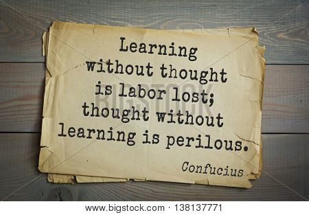 Ancient chinese philosopher Confucius quote on old paper background. Learning without thought is labor lost; thought without learning is perilous.