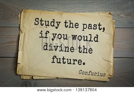 Ancient chinese philosopher Confucius quote on old paper background. Study the past, if you would divine the future.