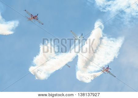 FARNBOROUGH, UK - July 5: Global Stars formation aerobatic display team in the skies over Farnborough Hampshire, UK on July 5, 2016