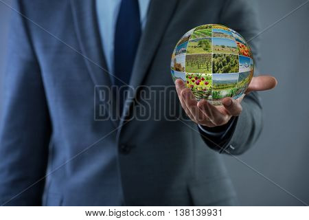 Man holding earth with nature photos