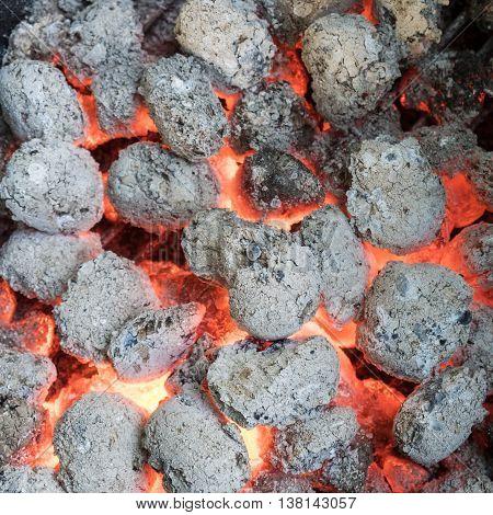 Texture embers closeup. Embers after a coal fire
